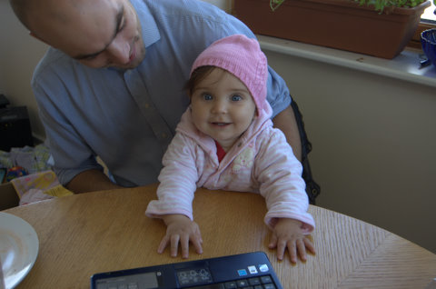 Mersina in a pink hat with her godfather